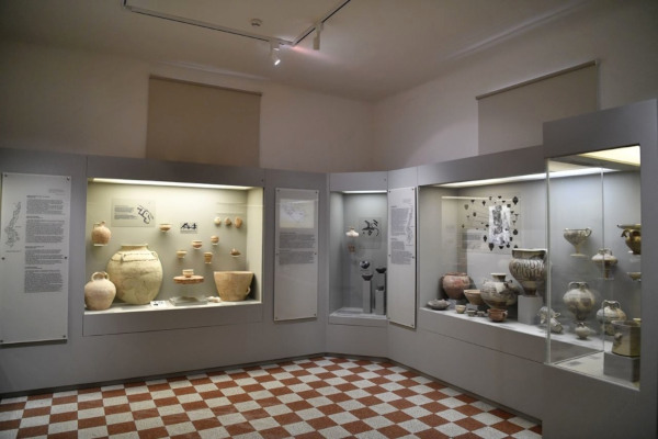 Inside one of the rooms of the Archaeological Museum of Karpathos with exhibits and artifacts in the displays.