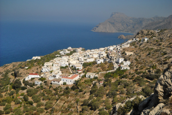 An overview of the Mesochori village in Karpathos with the blue sea in the background.