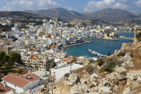 An overview of the Karpathos Town depicting the buildings and a part of the port.
