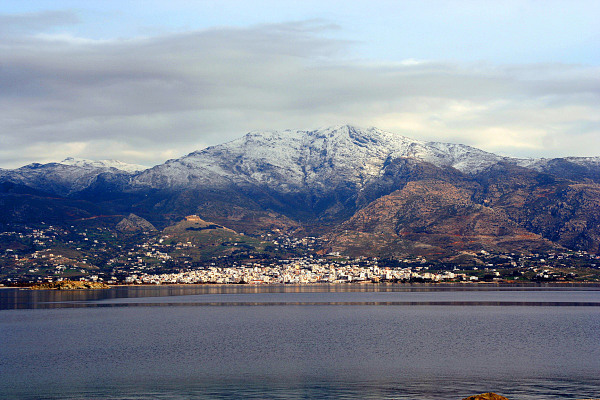 The impressive Ochi mountain with snowy peaks as a background of the town of Karystos.