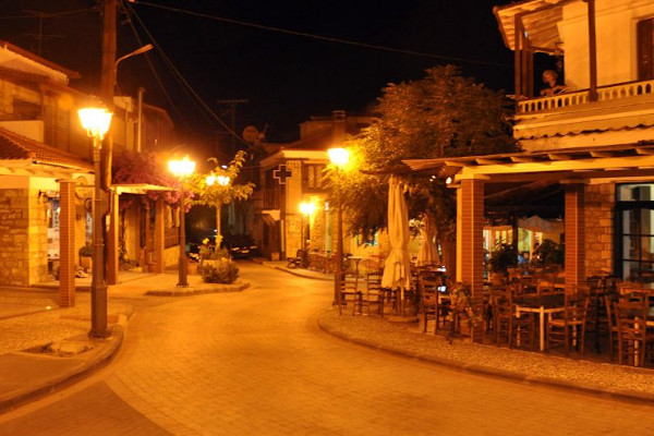 A night view of a central street of Paliouri where a taverna and other shops are situated.