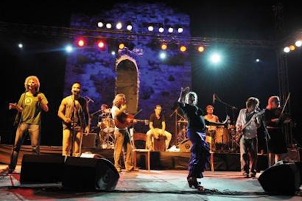 A band during a live concert on the stage of Sani Festival in Halkidiki.