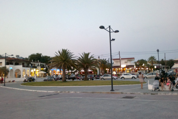A square surrounded by shops and tavernas at Skala Fourkas.