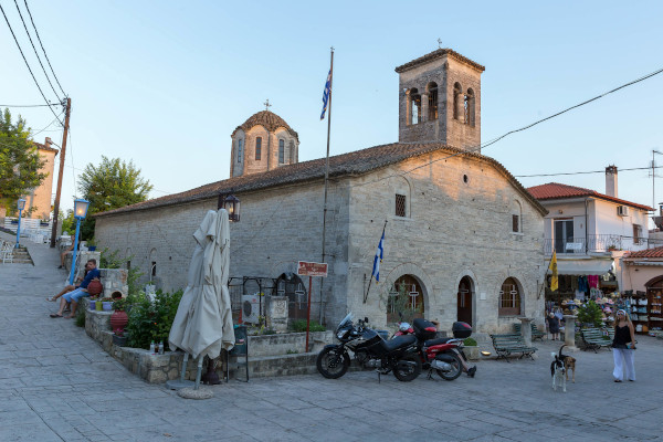 A picture that depicts the church of St. Demetrios in the center of Afitos.