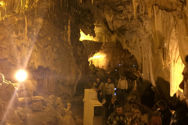 Visitors on a guided tour inside the Dragon's Cave of Kastoria.