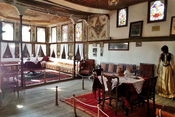 Inside a room of the Folklore Museum of Kastoria with typical furniture and decoration of a mansion.