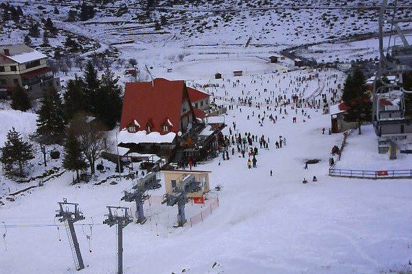 The snowy slope of Seli ski resort where the chalet and many guests are visible.