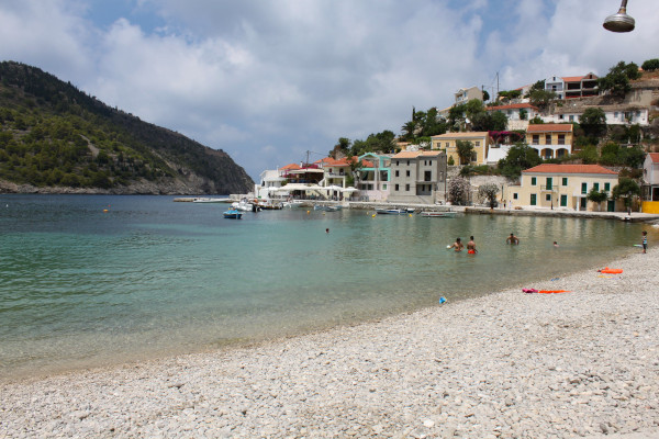 The beach with the blue-green waters and a part of the settlement of Assos on Kefalonia.