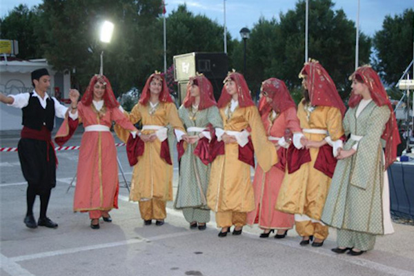 A group dressed in traditional clothes are dancing during the Hippocratia Festival in Kos island.