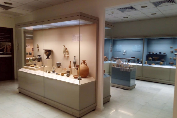 Displays with exhibits in a room of the Archaeological Collection Museum of Kozani