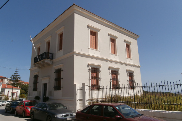 The exterior of the neoclassical building that hosts the Folklore Museum of Kymi.