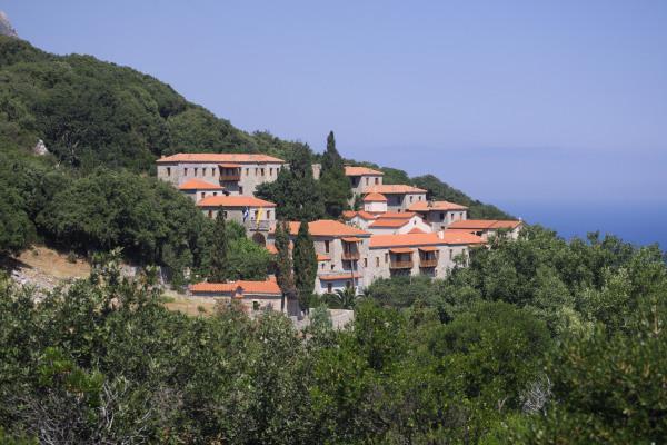 The stone-built monastery of Metamorfosis Sotiros in Kymi among the dense vegetation.