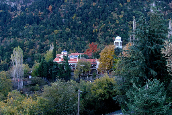 A distant photo of Agathonos Monastery that is surrounded by the lush forest vegetation.