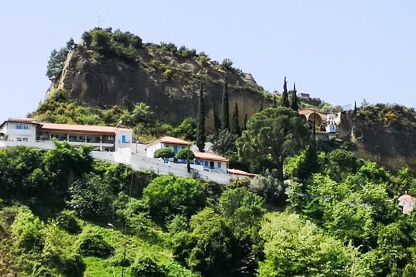 The convent of Panayia Kremasti at Lanthi of Pyrgos surrounded by dense vegetation.