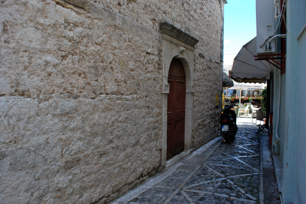 One of the side entrances of the church of the St. Spyridon in Lefkada town located by a narrow street.