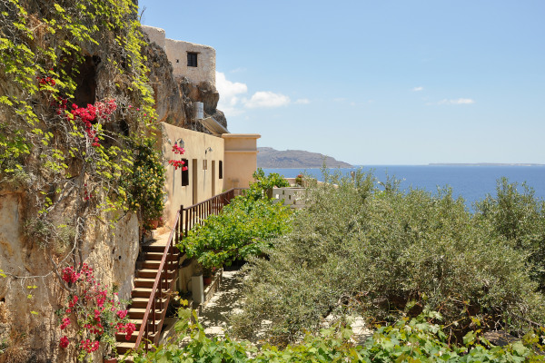 A part of the facilities of the Kapsa monastery with the great view of the Libyan Sea in the background.