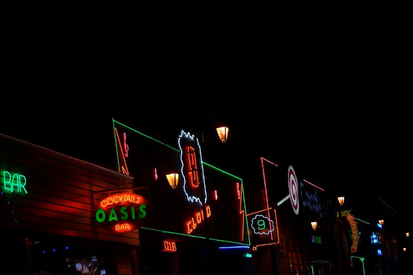 Neon signs of bars and clubs during the night.