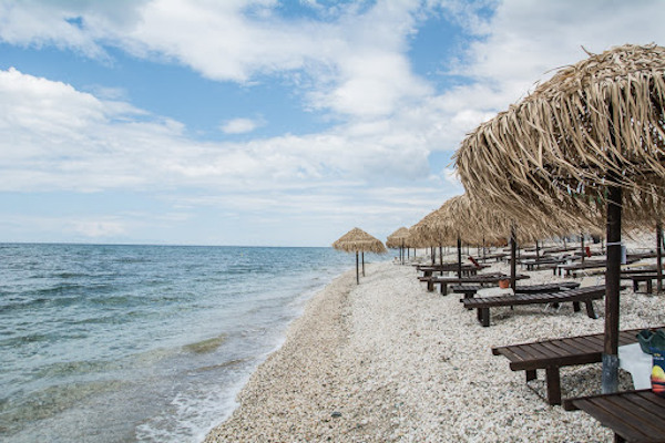 An image of many umbrellas and sunbeds at the Kagkeles beach of Rhodope.