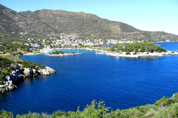 An overview of the coastal town of Methana as it is built at the foothills of the mountain and by beautiful bays.