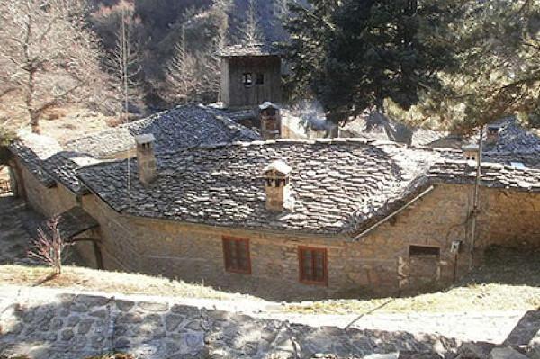A picture depicting the stone-build exterior of the Koimiseos Theotokou Monastery of Metsovo.