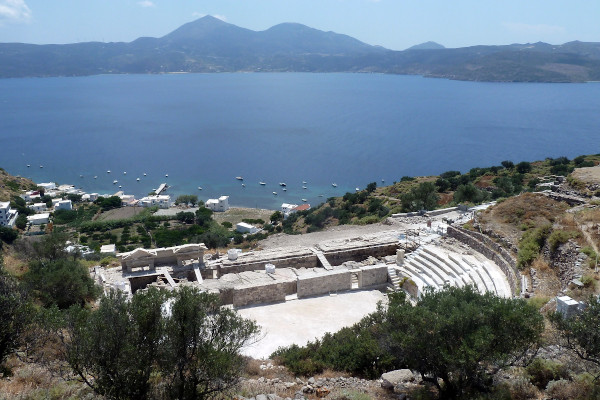 A panoramic picture showing the Ancient Theater of Milos with the spectacular view of the sea in the background.