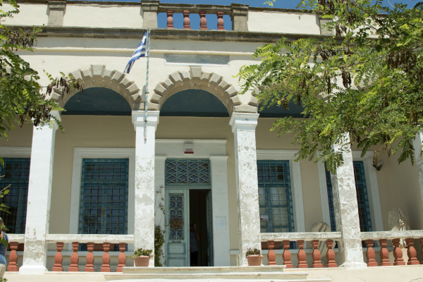 The front side and the main entrance of the Archaeological Museum of Milos in Plaka.