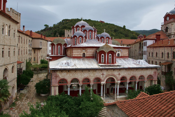 The main church of Esphigmenou Monastery surrounded by buildings that host the cells of the monks and other facilities.