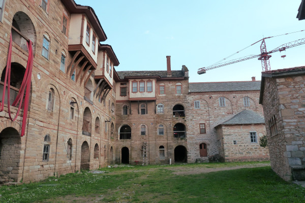 The inner yard of the Great Lavra Monastery with a crane at the background that helps at the renovation works.