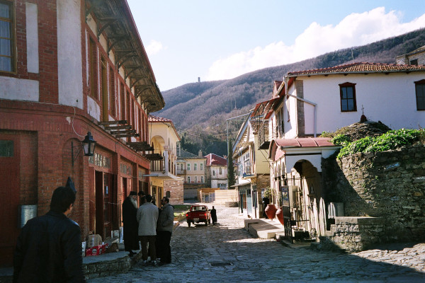 A central cobbled street of Karyes in Mount Athos and houses with the typical traditional architecture.