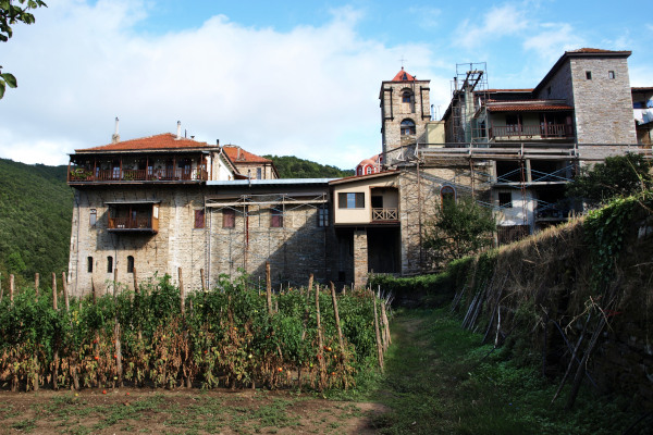 A view of the exterior of Konstamonitou with the vegetable garden that is located outside the walls of the monastery.