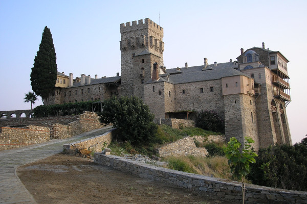 The road leading to the main entrance of Stavronikita and the monastery exterior with the dominating defensive tower.