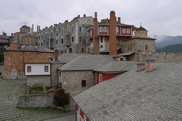 Part of the inner yard with a church, buildings that host monks' cells, and other facilities of the Vatopedi Monastery.