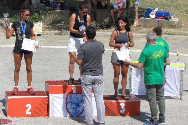 After the end of the Olympus Marathon, the winners on the pedestal receive their medals from the judges.