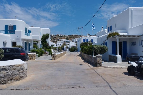 A picture showing the coastal settlement of Ornos in Mykonos.