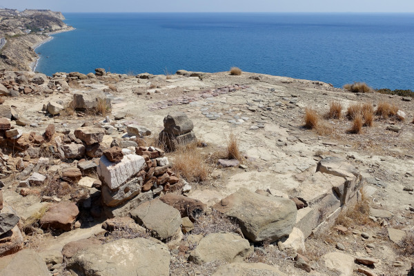 Remains of the Archaeological Site Pyrgos Myrtos with the blue sea in the background.