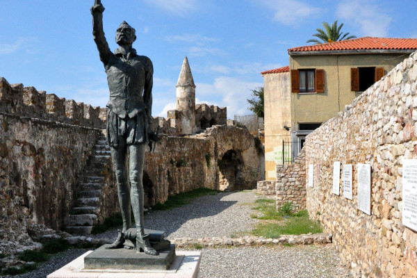 A photo of the statue of Cervantes at the right corner of the old port of Nafpaktos (Lepanto).