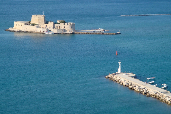 An overview of the Bourtzi Castle of Nafplio in the entrance of the port of the city.