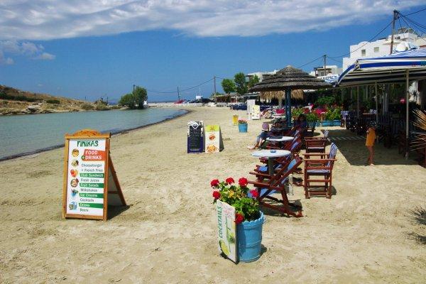A part of Agios Georgios Beach on Naxos island with the facilities offered by the local beach bars and restaurants.