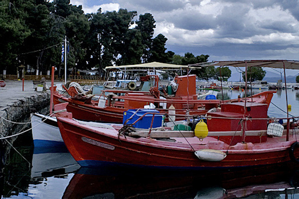 Small fishing boats anchored in the port of Nea Anchialos near Volos.