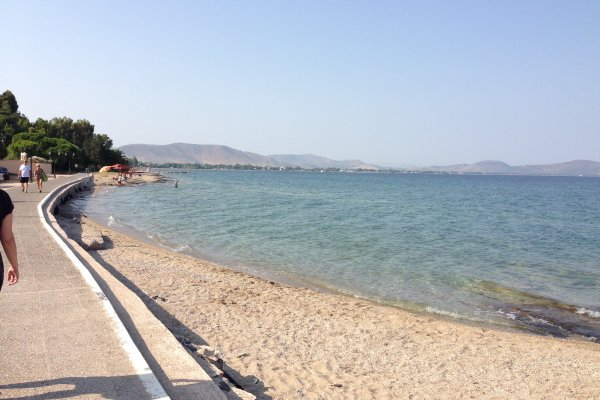The seafront promenade at Nea Makri area that passes by the sandy beach.