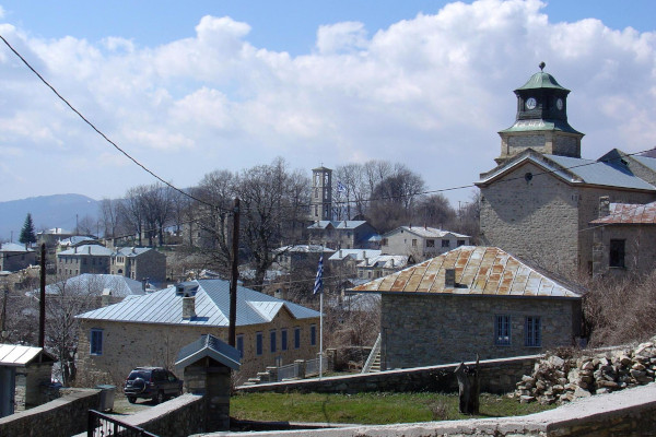 Overview of the buildings of the central part of Nymfaio, with the belfry of St. Nicholas church visible in the middle.
