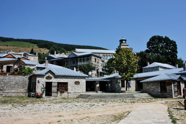 The central square of the village surrounded by traditional stone-built houses.