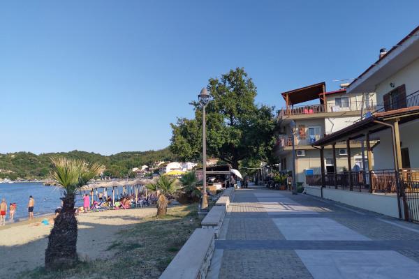 The coastal promenade next to the beach of Olympiada.