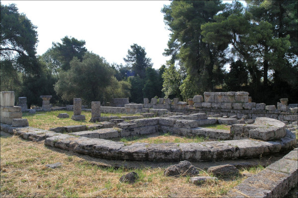 The remains of the Bouleuterion of Olympia among the trees.
