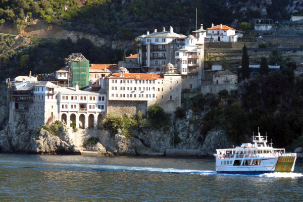 A picture taken for the daily cruises ship and depicts the ferry boat with a monastery in the background.