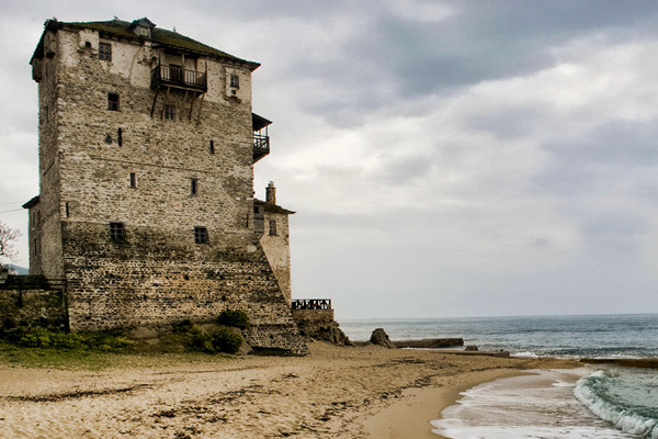 The tower of Prosphorion at the seafront of Ouranoupoli during a cloudy day.