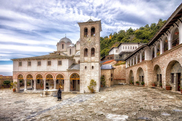 Exterior view of the Panagia Eikosifoinissa Monastery with the main church and some of the surrounding buildings.