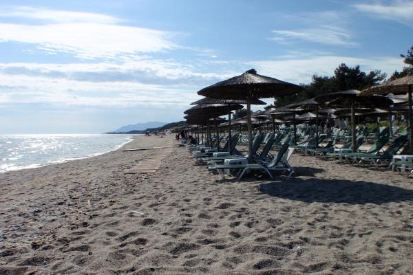 Sunbeds and umbrellas at the Agia Paraskevi (Panorama) Beach of Makri at Evros.