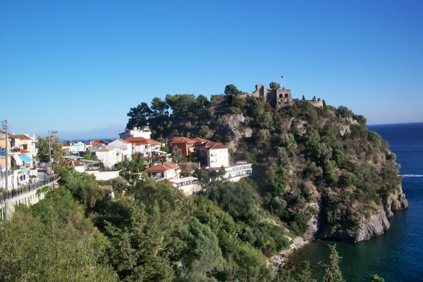 The Venetian Castle of Parga at the edge and highest point of a rocky peninsula, very close to the city buildings.