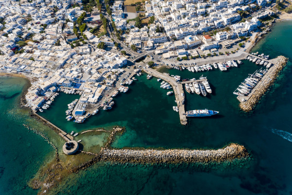 An overview of the settlement of Naousa of Paros with its port full of fishing boats.